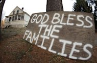 "A sign reads ""God Bless the Families"" outside of a home near the Sandy Hook School in Newtown, Connecticut on December 15, 2012. Sandy Hook Elementary School teacher Kaitlin Roig has told ABC News how she and 15 first graders cowered in a dark, barricaded bathroom as the gunman went on the rampage"