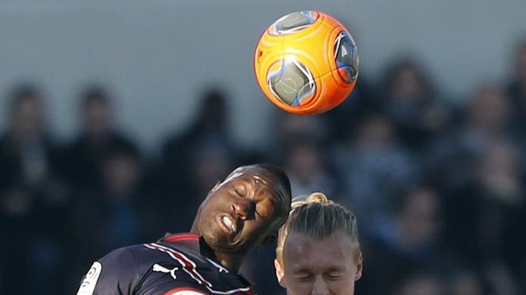Henri Saivet of Girondins Bordeaux fights for the ball with Simon Kjaer of Lille during their French Ligue 1 soccer match at the Chaban Delmas Stadium in Bordeaux