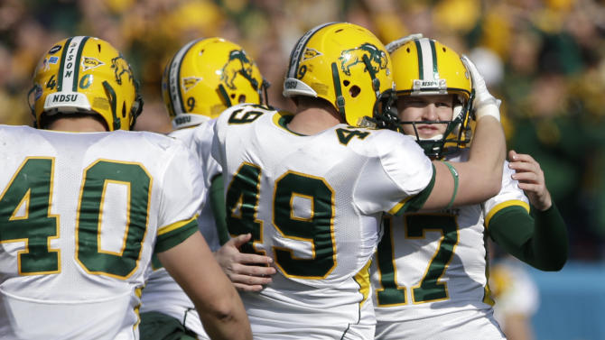 North Dakota State's Andrew Grothmann (40) and Derek Lee (49) congratulate kicker Adam Keller (17) following his field goal kick against Sam Houston State in the first half of the FCS Championship NCAA college football game, Saturday, Jan. 5, 2013, in Frisco, Texas. (AP Photo/Tony Gutierrez)