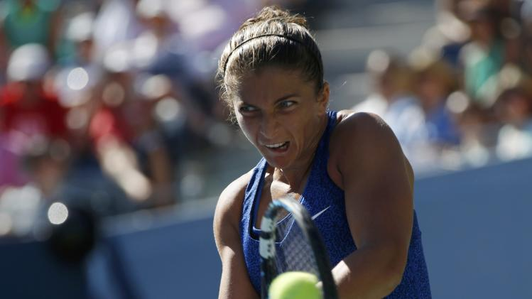 Sara Errani of Italy hits a return to Venus Williams of the U.S. during their match at the 2014 U.S. Open tennis tournament in New York