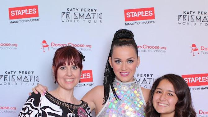 "IMAGE DISTRIBUTED FOR STAPLES - Global pop star Katy Perry, center, with local teacher and student from Anaheim High School, left to right, Christie Naranjo and Elissa Saucedo, backstage at the Honda Center during her Prismatic World Tour performance on Wednesday, September 17, 2014 in Anaheim. Staples teamed up with superstar Katy Perry to ""Make Roar Happen"" and celebrate and support teachers during the back-to-school season by donating $1 million to DonorsChoose.org, a charity that has helped fund more than 450,000 classroom projects for teachers and impacted more than 11 million students. (Photo by Antonio Pullano/Invision for Staples/AP Images)"