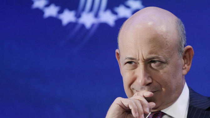 FILE - In this Monday, Sept. 24, 2012, file photo, Lloyd Blankfein, Chairman and CEO of Goldman Sachs, attends the Clinton Global Initiative in New York. Goldman Sachs easily beat analysts' estimates for earnings and revenue in 2012's third quarter, bouncing back from a loss in the same period a year ago. The investment bank also said it would raise its dividend. (AP Photo/Mark Lennihan)