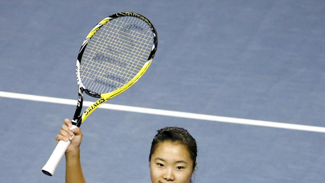 Nara of Japan waves to audience after defeating Govortsova of Belarus during their FedCup match in Tokyo