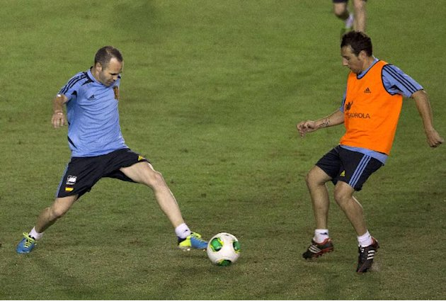 Spain's Andres Iniesta, left, and Santiago Cazorla vie for the ball during a Confederation Cup soccer training session in Rio de Janeiro, Brazil, Tuesday, June 18, 2013