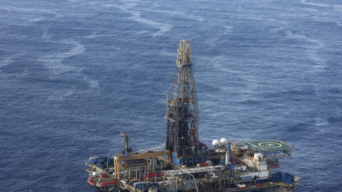 FILE - In this Monday Nov. 21, 2011 file photo, provided by the Cyprus Press and Information office, the Noble Energy company's offshore oil and gas rig is seen some 115 miles (185 kilometers) off Cyprus' south coast. Cyprus said Thursday, Oct. 3, 2013, its plan to turn itself into a regional energy hub remains on track, despite new findings showing that an offshore gas field is noticeably smaller than initially estimated. The small Mediterranean island nation, which earlier this year became the fifth country that uses the euro to receive outside financial assistance, is aiming to build a multibillion euro facility by 2019-20 to liquefy excess gas supply for export to Europe and beyond. (AP Photo/Cyprus Press and Information Office, File)