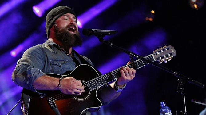 "FILE - This June 6, 2013 file photo shows Zac Brown performing at the 2013 CMA Music Festival in Nashville,Tenn. When Zac Brown bumped into Dave Grohl while picking up some altered clothes for the Grammy Awards, he didn't let the random meeting go to waste. They bonded over their love of analog recording gear and their new friendship eventually resulted in Zac Brown Band's newest release: ""The Grohl Sessions Vol. 1."" (Photo by Wade Payne/Invision/AP, File)"