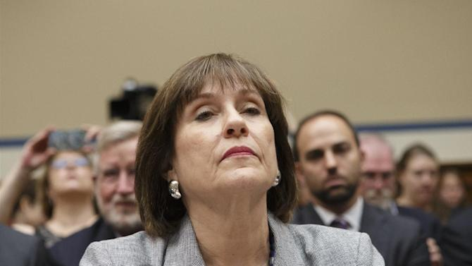 FILE - In this May 22, 2013 file photo, Internal Revenue Service official Lois Lerner refuses to answer questions as the House Oversight Committee holds a hearing to investigate the extra scrutiny the IRS gave Tea Party and other conservative groups that applied for tax-exempt status, on Capitol Hill in Washington. A House committee is voting whether to hold the former Internal Revenue Service official in contempt of Congress for refusing to answer questions at a pair of hearings. Lerner previously headed the IRS division that processes applications for tax-exempt status. (AP Photo/J. Scott Applewhite, File)