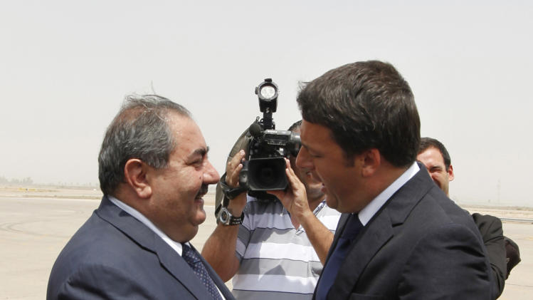Iraq's Foreign Minister Hoshiyar Zebari, left, shakes hands with Italy's Prime Minister Matteo Renzi in Baghdad, Iraq, Wednesday, Aug. 20, 2014. Renzi started a one-day visit to Iraq, meeting with the outgoing Prime Minister, Nouri al-Maliki, and premier-designate, Haider al-Abadi, along with other officials. (AP Photo/Ahmed Saad, Pool)