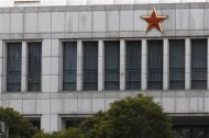 Part of the building of 'Unit 61398', a secretive Chinese military unit, is seen in the outskirts of Shanghai February 19, 2013. The unit is believed to be behind a series of hacking attacks, a U.S. computer security company said, prompting a strong denial by China and accusations that it was in fact the victim of U.S. hacking. REUTERS/Carlos Barria (CHINA - Tags: POLITICS SCIENCE TECHNOLOGY MILITARY) - RTR3DZ82
