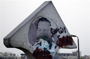 """A defaced picture of former Egyptian President Hosni Mubarak with graffiti that reads, """"Corrupt and deposed"""" along a highway in Cairo August 21, 2013. REUTERS/Amr Abdallah Dalsh"""