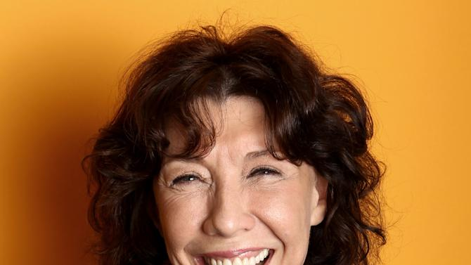 "In this Friday, March 15, 2013 photo, actress Lily Tomlin poses for a portrait at the Four Seasons Hotel, in Los Angeles. For Tomlin, 70 is the new 30, at least momentarily. In the Paul Weitz directed comedy ""Admission,"" opening March 22, Tomlin plays the young-at-heart feminist mother of a university admissions officer, portrayed by Tina Fey.  (Photo by Matt Sayles/Invision/AP)"
