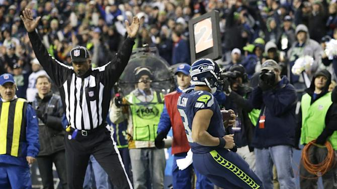Seattle Seahawks quarterback Russell Wilson (3) runs for a  touchdown against the St. Louis Rams in the second half of an NFL football game, Sunday, Dec. 30, 2012, in Seattle. (AP Photo/Elaine Thompson)