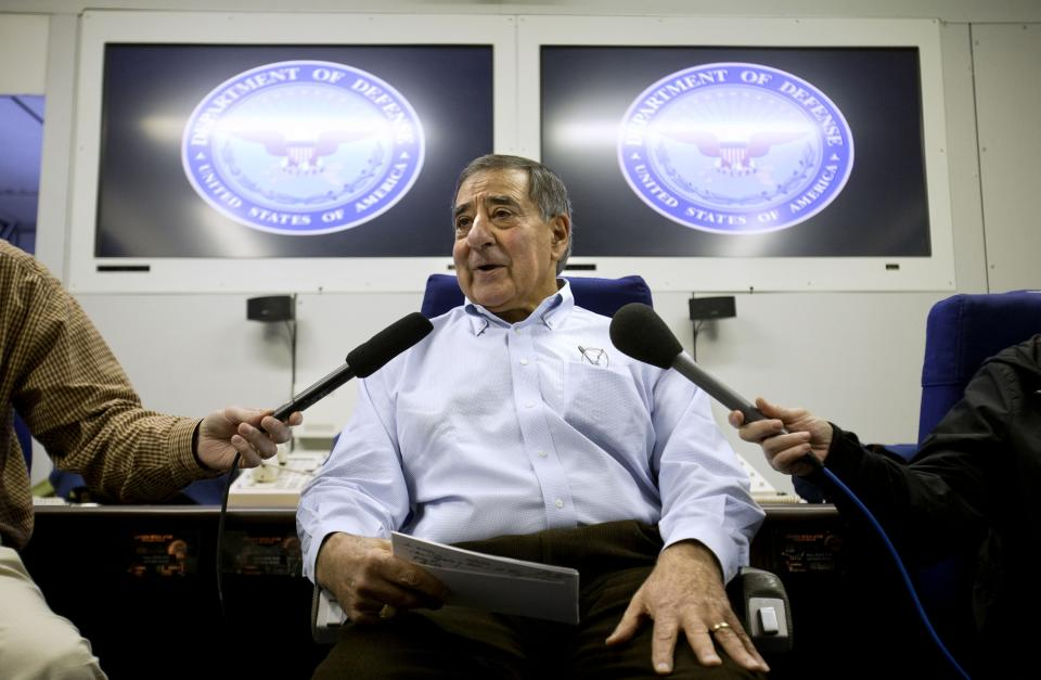 U.S. Defense Secretary Leon Panetta speaks to the traveling press aboard his plane en route to Lisbon, Portugal, on Monday, Jan. 14, 2013, on what is expected to be his last overseas trip as secretary. (AP Photo/Jacquelyn Martin)