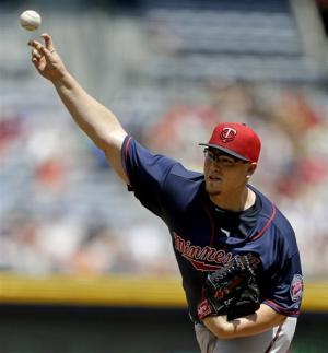 Gattis grand slam leads Braves past Twins 8-3