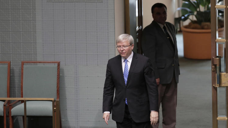 Former Australian Prime Minister Kevin Rudd walks in the chambers in the parliament during question time in Canberra, Australia, Wednesday, June 26, 2013. Supporters of Prime Minister Julia Gillard's chief intra-party rival are again pushing for a vote to oust the Australian prime minister this week. (AP Photo/Rick Rycroft)