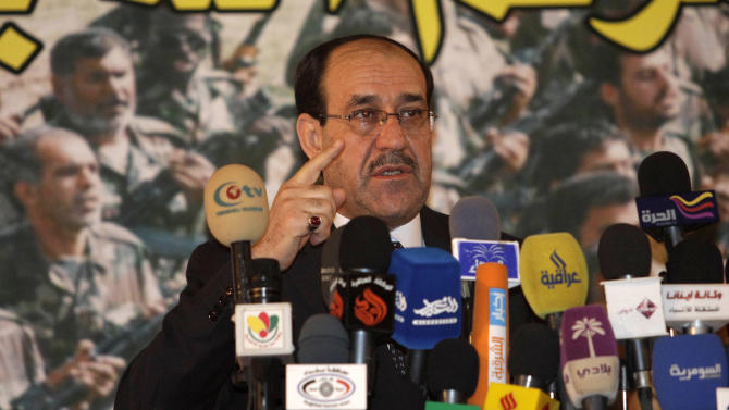 Iraqi Prime Minister Nouri al- Maliki speaks to the press during the 30th anniversary of the founding of the Badr Organization in Baghdad, Iraq, Thursday, Aug. 18, 2011. The Badr Organization  is an Iraqi political party headed by Hadi al-Amiri. Previously it was the armed wing of the Supreme Council for Islamic Revolution in Iraq but since the 2003 invasion of Iraq most of its fighters have entered the new Iraqi army and police force and it officially became a completely political organisation.(AP Photo/Karim Kadim)