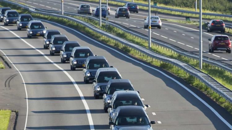 A row of hearses carrying victims of the Malaysia Airlines Flight MH17 plane disaster are escorted on highway A27 near Nieuwegein