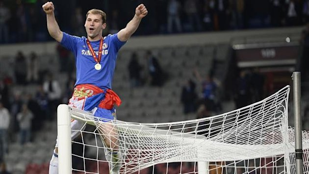 Chelsea's Branislav Ivanovic sits on a goalpost after they defeated Benfica in the Europa League final (Reuters)