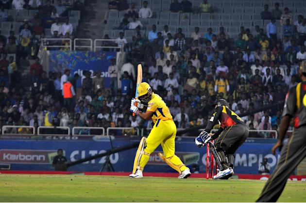 Chennai Super Kings captain MS Dhoni plays a shot against Hyderabad Sunrisers at Champions League Twenty-20 match at Jharkhand State Cricket Association (JSCA) International Cricket Stadium in Ranchi