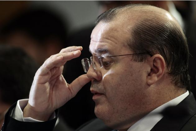 Brazilian central bank chief Alexandre Tombini reacts during for a public hearing on the Economic Affairs Committee at the Brazilian Federal Senate in Brasilia