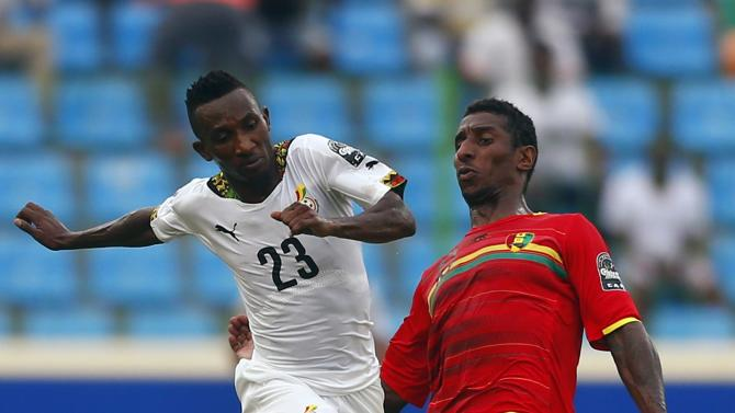 Harrison Afful of Ghana fights for the ball with Guinea's Kevin Constant during their quarter-final soccer match of the 2015 African Cup of Nations in Malabo