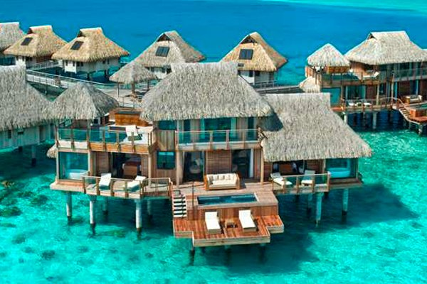 "<div class=""caption-title""><b>1. Presidential Suite At Hilton Bora Bora In Nui, Tahiti</b></div><p>  Overwater bungalows are du riguer in French Polynesia, but not many can boast that they have two stories and an ultra-secluded position at the edge of a long pontoon. This two-bedroom suite offers all that, plus a private pool, an outdoor Jacuzzi, a dedicated in-room spa area, two living rooms and three bathrooms. Décor is traditional Tahitian, with natural woods and tropical prints. Nothing beats a morning cannonball into the multi-blue toned water, just off your sprawling deck. For more info, visit <a href=""http://www.bridalguide.com/planning/wedding-reception/fall-wedding-ideas"">hilton.com</a>. </p>"