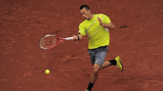 Philipp Kohlschreiber returns the ball to Nicolas Almagro during the Barcelona semifinal open tennis in Barcelona, Spain, Saturday, April 27, 2013. Almagro won 6-2, 6-1. (AP Photo/Manu Fernandez)