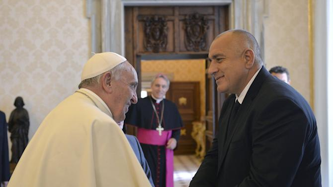 Pope Francis is greeted by Bulgaria's Prime Minister Borissov during a private audience in the pontiff's studio at the Vatican