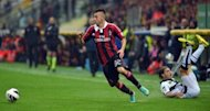 AC Milan's forward Stephan El Shaarawy (R) escapes with the ball during their Serie A football match against Parma at Ennio Tardini stadium in Parma. The match ended in a 1-1 draw