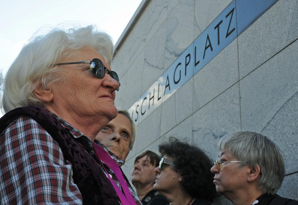 People gather at the Umschlagplatz monument at the start of commemorations marking the 70th anniversary of first transport of Jews from the Warsaw Ghetto to the Treblinka death camp during World War II,  in Warsaw, Poland, Sunday, July 22, 2012.  ( AP Photo/Alik Keplicz)