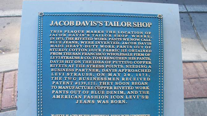 This Wednesday, Oct. 1, 2014, photo shows the historical marker for Jacob Davis' tailor shop in Reno, Nev., where riveted denim jeans were first created. Nevada tourism officials are planning a three-day festival next fall to celebrate and promote the city as the birthplace of what became modern blue jeans.  (AP Photo/Scott Sonner)
