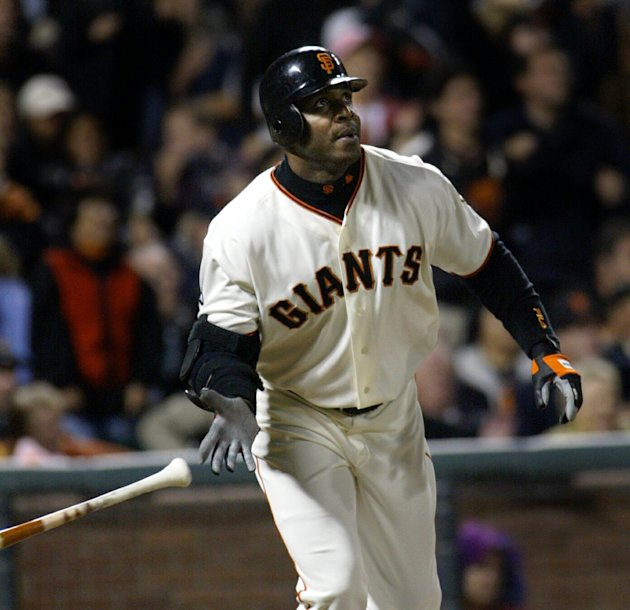 FILE - This Sept. 16, 2003, file photo shows San Francisco Giants' Barry Bonds watching the flight of his 656th career home run off San Diego Padres pitcher Adam Eaton,  in the fifth inning,  in San F