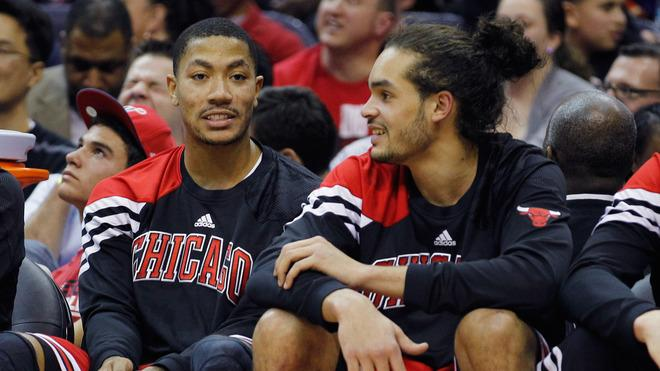 Derrick Rose #1 (L) Talks Getty Images