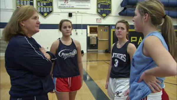Mom coaches three daughters on same team