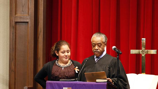 The Rev. Al Sharpton, right, reads a letter from President Barack Obama to Xea Myers 11-year-old daughter of  Dwight Errington Myers, later known as Heavy D, during his funeral at Grace Baptist Church in Mount Vernon, N.Y., Friday, Nov. 18, 2011. The rapper, producer and actor died on Nov. 8, in Los Angeles.  (AP Photo/David Karp)