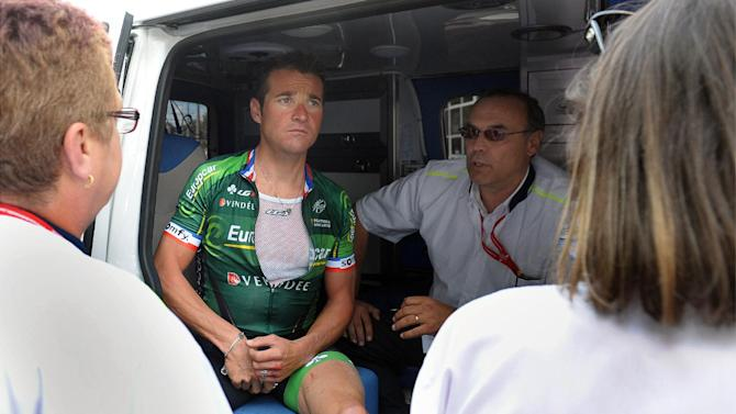 France's Thomas Voeckler sits in an ambulance in Limoges, after his accident on August 19, 2014