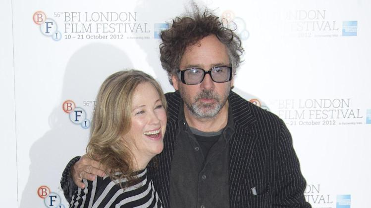 "Director Tim Burton and actress Catherine O'Hara hug at a photocall for Burton's ""Frankenweenie"", during the London Film Festival at The Odeon, Leicester Square on Wednesday, October 10, 2012 in London, UK. (Photo by Joel Ryan/Invision/AP)"