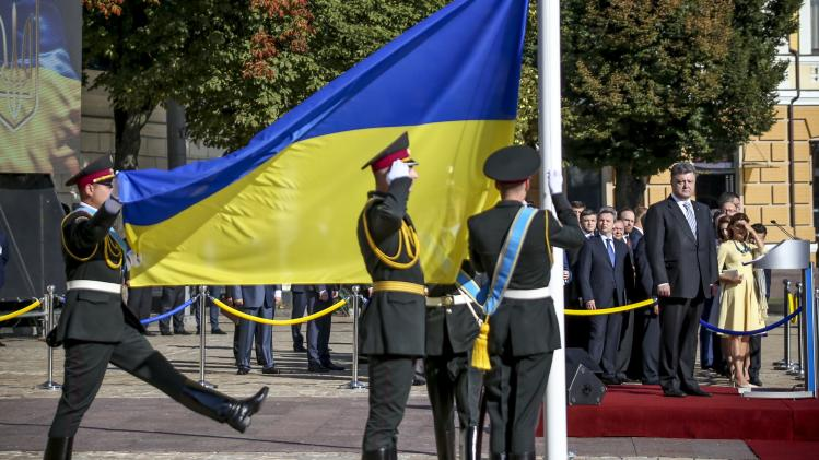Poroshenko attends a ceremony for the Day of the State Flag in Kiev
