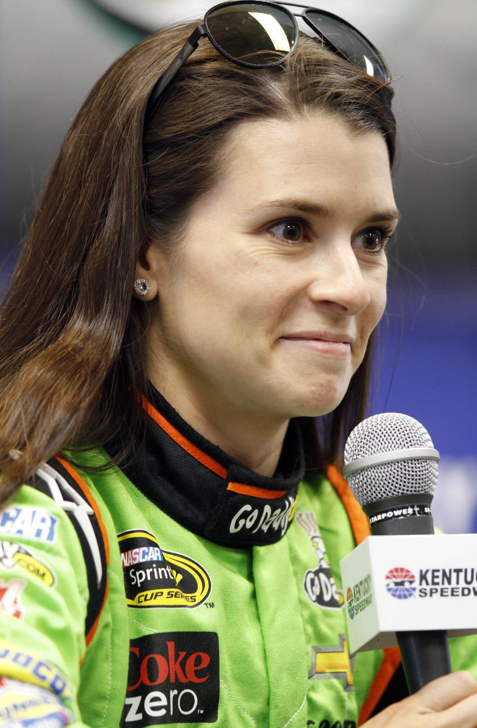 Danica Patrick answers a question during a news conference for the NASCAR Sprint Cup auto race at Kentucky Speedway in Sparta, Ky., Friday, June 28, 2013. (AP Photo/James Crisp)