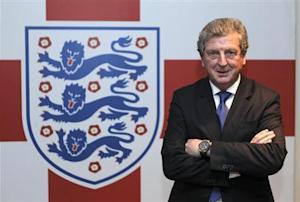 Newly appointed England soccer manager Roy Hodgson poses for a photograph in the tunnel at Wembley Stadium in London
