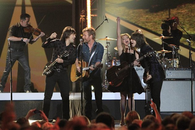 Dierks Bentley, second from left, and from left, Neil Perry, Kimberly Perry and Reid Perry, of the musical group The Band Perry, perform at the Grammy Nominations Concert Live! at Bridgestone Arena on