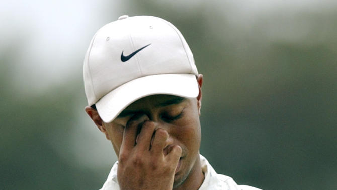 FILE - In this Saturday, June 19, 2004, file photo, Tiger Woods reacts on the fifth fairway after his shot toward the green during the third round of the U.S. at Shinnecock Hills Golf Club in Southampton, N.Y. Nike forgave a contrite Tiger Woods after his infidelity was exposed. It welcomed back an apologetic Michael Vick once he served time for illegal dog-fighting. But the company dropped Lance Armstrong, Wednesday, Oct. 17, 2012, faster than the famed cycler could do a lap around the block. (AP Photo/Charles Krupa, File)