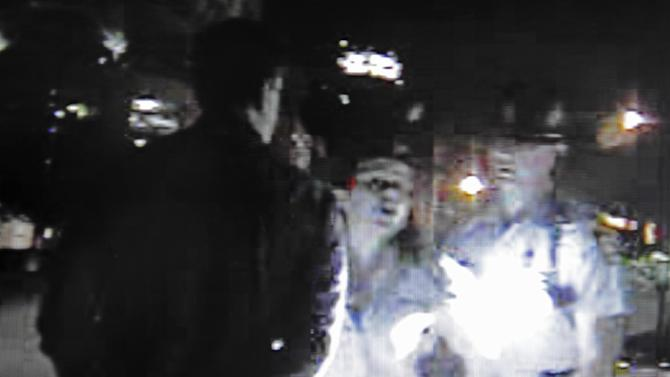In this video screen still image released by the Georgia State Police, Friday, May 3, 2013, in Atlanta, actress Reese Witherspoon speaks with a Georgia State Trooper, in Atlanta. Her husband, Hollywood agent Jim Toth, is seen at left being arrested for suspicion of being under the influence on April 19. (AP Photo/Georgia State Police)