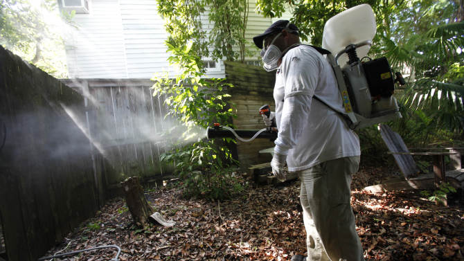 In this Thursday, Oct. 4, 2012 photo, Jason Garcia, a field inspector with the Florida Keys Mosquito Control District, tests a sprayer that could be used in the future to spray pesticides to control mosquitos in Key West, Fla. The British company Oxitec and mosquito control officials hope to release genetically modified mosquitoes to control the Aedes aegypti mosquito population, that can transmit dengue fever, without using pesticides and at relatively a low cost. But some Key West residents and environmental groups think the genetically modified mosquitoes pose a bigger threat than regular dengue or even dengue hemorrhagic fever. They worry the modified genetic material will somehow be passed to humans and the Keys ecosystem and they want more research into the potential risks. (AP Photo/Wilfredo Lee)