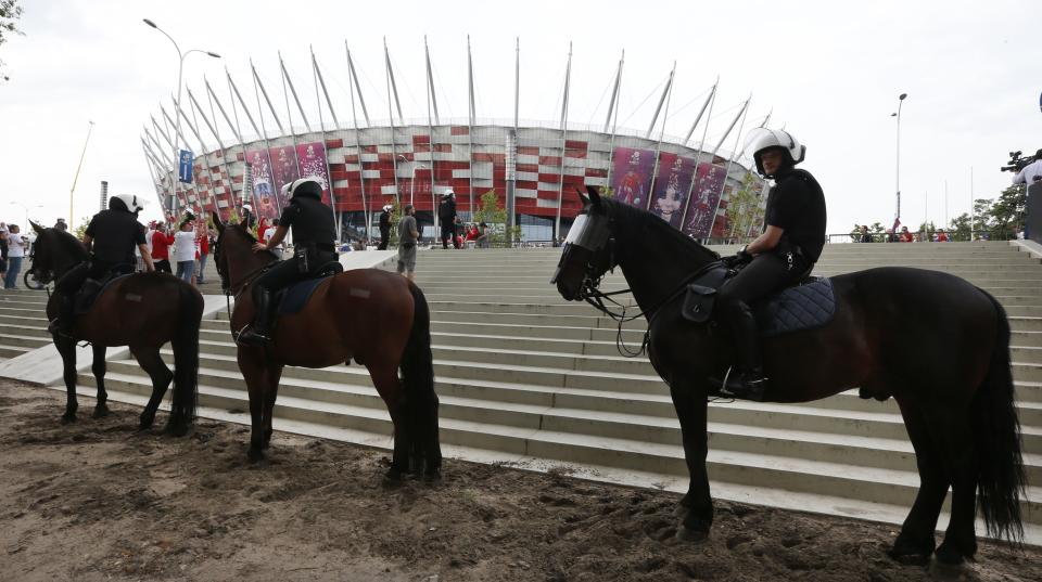 Polish mounted police block the access to the stadium prior to the group A Euro 2012 soccer match between Poland and Russia in Warsaw, Poland , Tuesday, June 12, 2012. (AP Photo/Czarek Sokolowski)