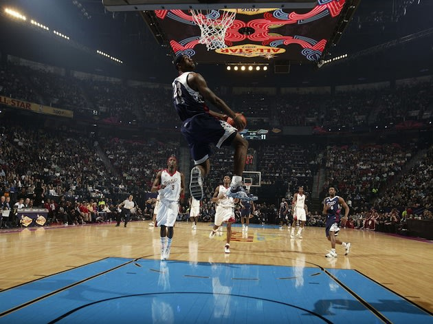 LeBron James throws down a reverse jam in a past All-Star game &#x002014; Getty Images