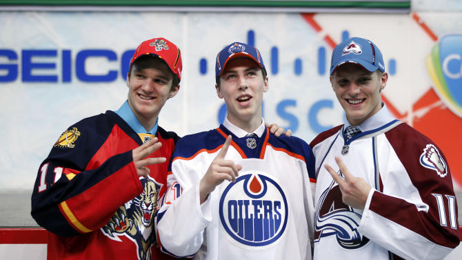 NHL top three draft choices Ryan Nugent-Hopkins, center, Gabriel Landeskog, right, and Jonathan Huberdeau pose after being drafted in the first round of the National Hockey League entry draft, Friday June, 24, 2011, in St. Paul, Minn. (AP Photo/Andy King)