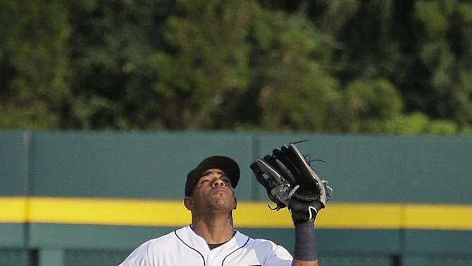 Detroit Tigers left fielder Yoenis Cespedes catches a fly ball hit by Toronto Blue Jays' Kevin Pillar during the second inning of a baseball game Friday, July 3, 2015, in Detroit. (AP Photo/Duane Burleson)
