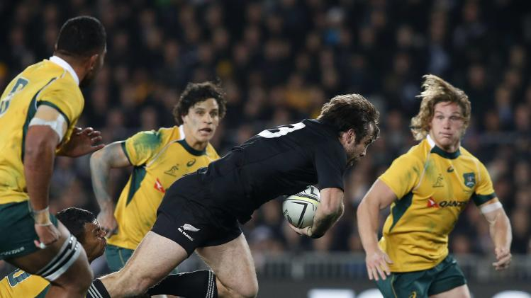 Beale of Australia's Wallabies tackles Smith of New Zealand's All Blacks during their Bledisloe Cup rugby championship match in Auckland