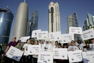 <p>               Local and international activists march to demand urgent action to address climate change at the U.N. climate talks in Doha, Qatar, Saturday , Dec. 1, 2012. (AP Photo/Osama Faisal)